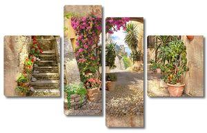 Улица с прекрасными цветами в горшках