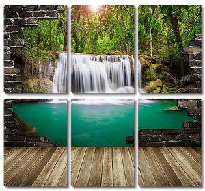 Вид на водопад через пролом в стене