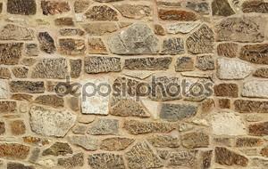 Бесшовные из тесаного старой каменной стены текстуры фона