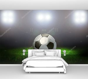 Футбольный мяч на поле стадиона со светом