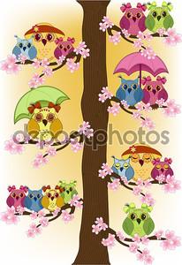Много совы, сидя на дереве