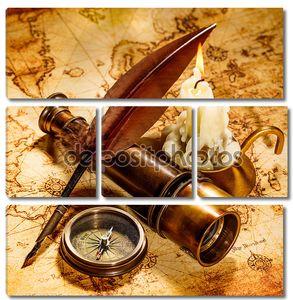 Старинный компас, гусиное перо на карте