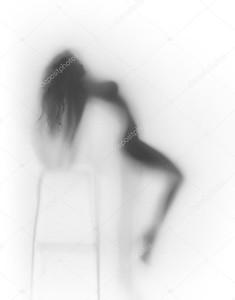 Очень сексуальная женщина тела силуэт за стеклянной стеной