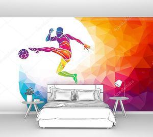 Творческий силуэт футболиста. Футболист бьет по мячу в модном абстрактном разноцветном многоугольнике с радужной спиной