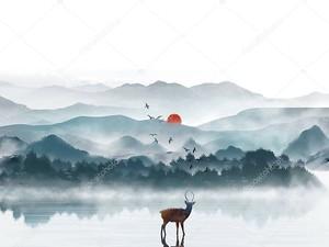 Одинокий олень на берегу озера