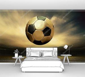 Мяч над полем на фоне заката