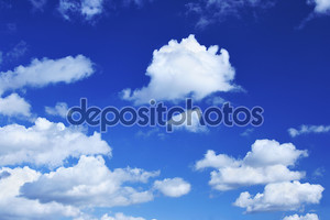Deep blue sky and lots small clouds