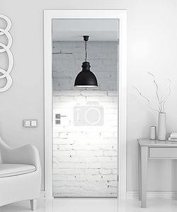 Светильник и белая кирпичная стена