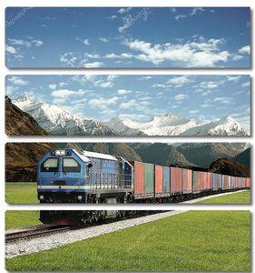 Грузовой поезд на фоне гор