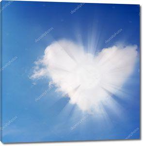 Абстрактные сердца и свет в небе.