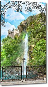 Вид на водопад и замок сквозь ажурную решетку террасы