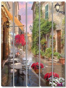 Уличное кафе во время дождя