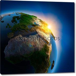 Восход солнца над земли в космическом пространстве