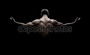 Вид сзади здоровые молодые мускулистый мужчина