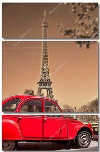 Эйфелева башня со старым красным автомобилем