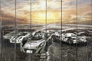 Спортивные автомобили на закате