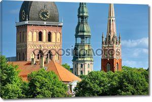 Латвийский башни церков в Риге