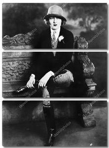 Женщина в костюме наездницы