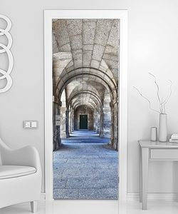 Series of Stone Arches Leading to a Door