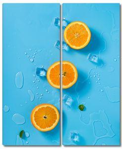 Дольки апельсина с кусочками льда