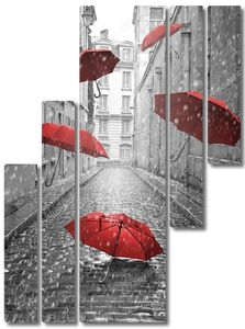 Red umbrellas flying on the street. Conceptual image