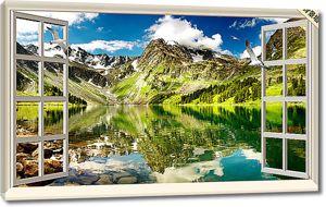 Вид из окна на горы над озером