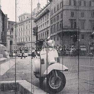 Vespa scooter on street