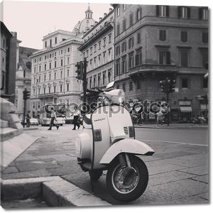 Vespa scooter on street