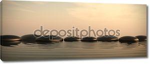 Zen камни в воде на восход