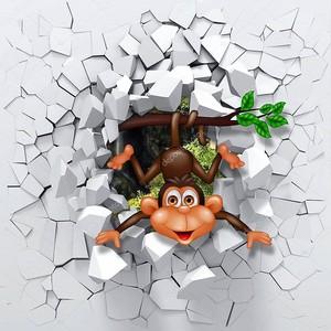 Маленькая обезьянка выглядывает из сломанной стены