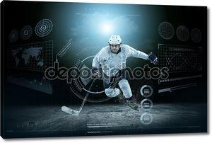 Хоккеист на льду в рампе света