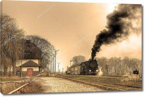 Паровой поезд остановился на маленькой станции