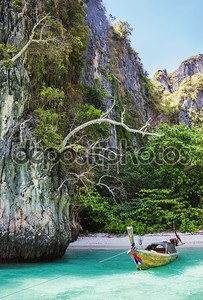 Traditional longtail boats in the famous Maya bay of Phi-phi Leh