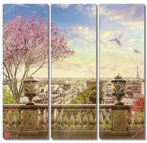 Панорама Парижа с цветущим деревом