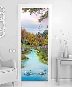 Лебеди на тихой осенней реке