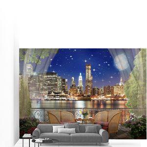 Вид с балкона на ночной город в огнях