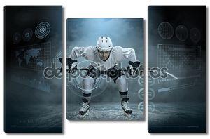 Хоккеист на льду при свете прожекторов