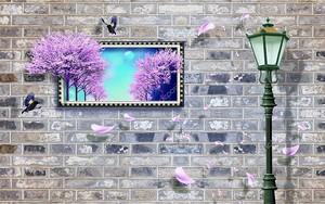 Фонарь и рама с изображением деревьев  у кирпичной стены