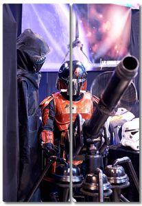 Star Wars fictional character testing a gun