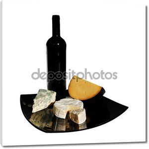 Бутылка вина и сыры