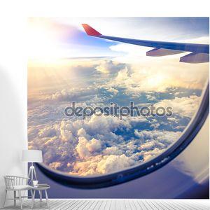 Облака и небо как сквозь окна самолета