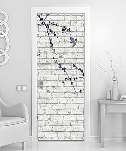 Ветка нарисованная на кирпичной стене