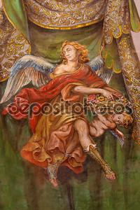Севилья, Испания - 28 октября 2014: фреска ангела с розами в церковной больнице de los venerables sacerdotes лояльным juan de valdes (1622 - 1690).