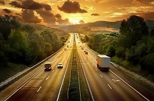 дорога Дорожного движения в закат