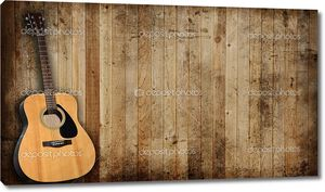 Гитара на деревянном фоне