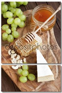 Still life with cheese, grape and honey