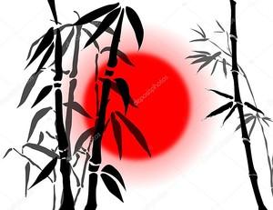 Ветви бамбука на красном солнце