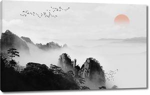 Закат в горах с тумане