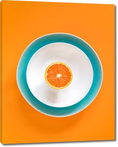 Апельсин на блюдце