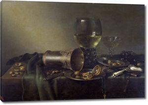 Виллем Клас Хеда. Натюрморт с серебряной вазой и часами